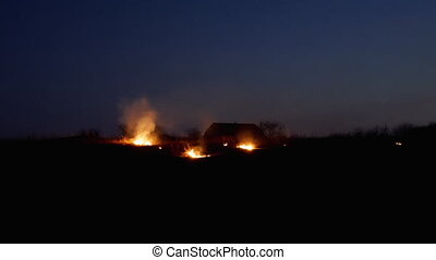 Fire on the farmers field at night