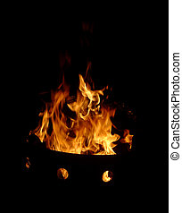 Fire Pit - A raging fire in a barrell.