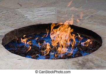 Ornamental fire pit with lava rocks and crystals