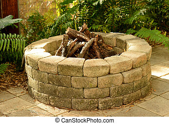 fire pit  - stone fire pit with bricks in the backyard
