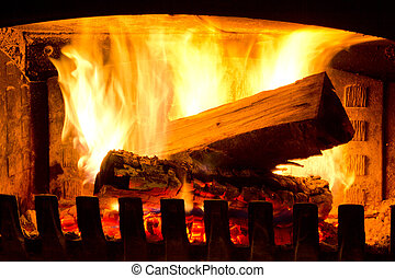 Fire Place - Fire place detail of a fire burning inside.