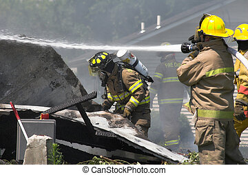 fire rescue 1 - Fire fighters look for victims in debree of...