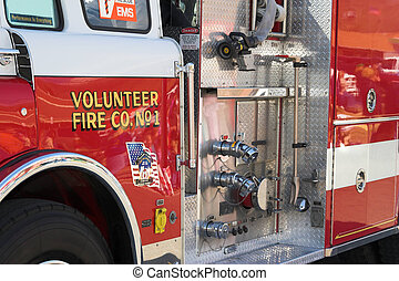 Fire & Rescue - Closeup of fire truck ready to fight a fire,...