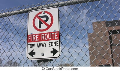 Fire route sign. No parking.