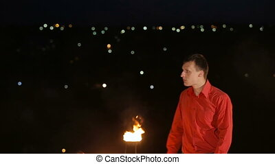 Fire show in the night. - Fire show artist breathe fire in...