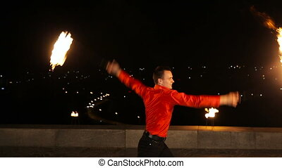 Fire show in the night. - Artist man rotates the...