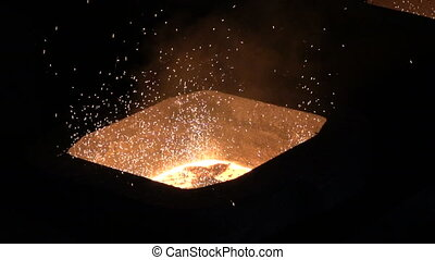 Fire sparks in the form of a hot metal