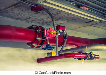 Fire sprinkler and red pipe ( Filtered image processed...