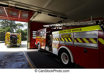 Fire station - A city fire station - doors open and fire...