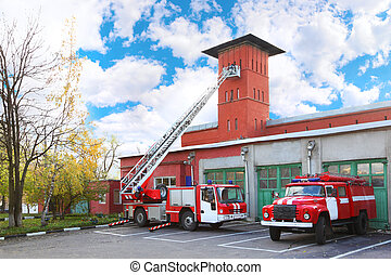 fire station, two red fire truck with long ladder, red high tower