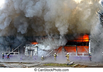 Structure fire with black smoke and heavy flames