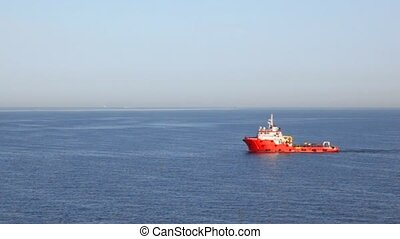 fire-tighting boat moving in sea - red fire-tighting boat...