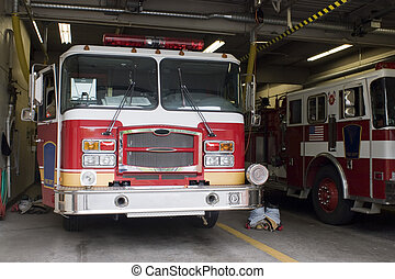 Fire Truck - A fire truck is parked in the bay with all of...
