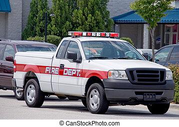 Fire Truck - An emergency vehicle known as a firetruck.