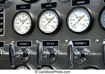 Fire truck gauges - Detail of gauges and levers on a fire ...