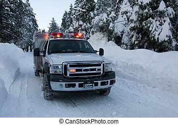 fire truck in winter - fire truck on a winter road in the...