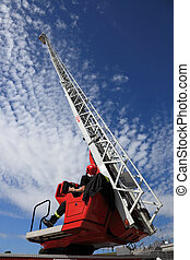 Fire truck ladder - Firefighter serving with the fire truck...