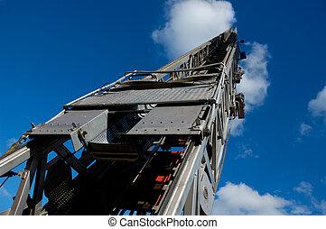 Fire Truck Ladder into Blue Sky