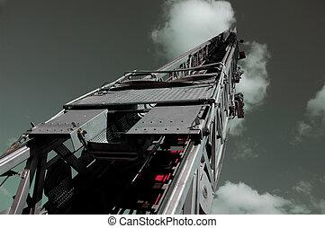 Fire Truck Ladder into Steel Gray Sky
