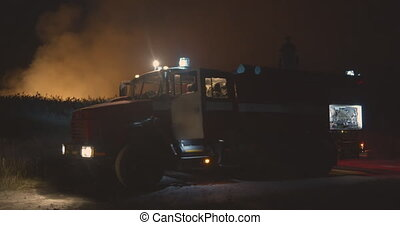 Fire truck with flashing lights on. Fire truck on background...