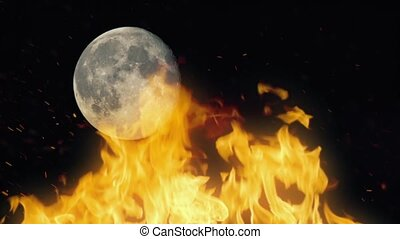Fire With Moon In Background - Large campfire burning...