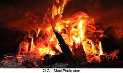 Fire wood brighly burning in furnace. Fire and flames