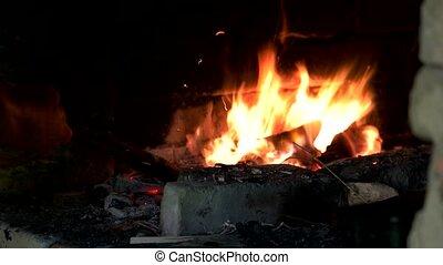 Fire wood burning in furnace. Blacksmith heating metal in ...