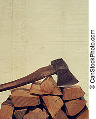 Fire wood with an old axe