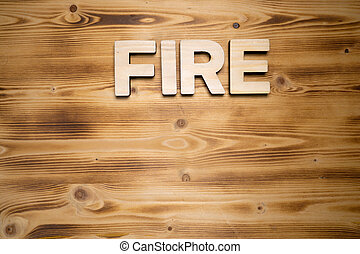 FIRE word made with building blocks on wooden board