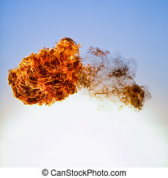 Fireball explosion on blue sky background