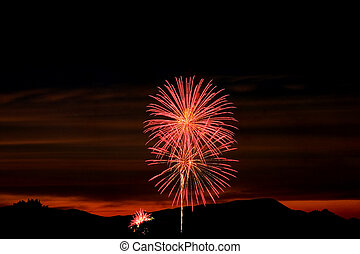 Firecrackers In The Sky During Sunset - Firecrackers During...