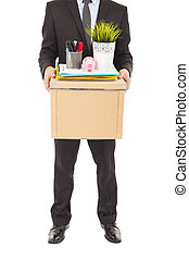 fired businessman carrying a box