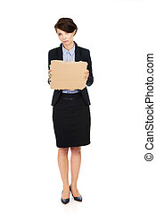 Fired businesswoman with a cardboard.