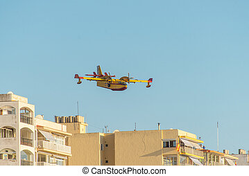 firefighter airplane above city