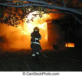A firefighter battles a blaze.