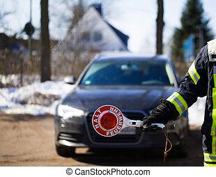 Firefighter blocks the road