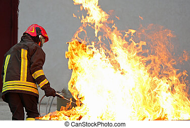 Firefighter during a training exercise off a huge fire in the br