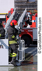 firefighter in the cage of fire engine
