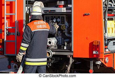 Firefighter on fire truck