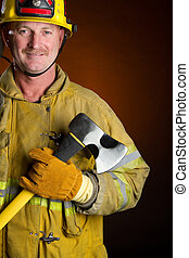 Firefighter - Smiling firefighter holding axe