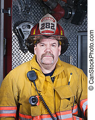 Firefighter Portrait in Turnout Gear in front of Apparatus