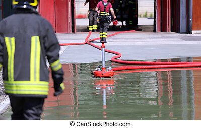 Firefighter positions a powerful fire hydrant during the exercises