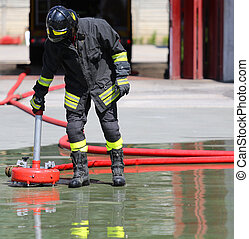 Firefighter positions a powerful fire hydrant in the fire station
