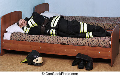 Firefighter sleeps - Firefighter sleeping dressed in Bunker...