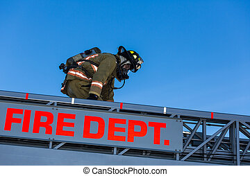 Firefighter training entering and exiting a building on a truck ladder