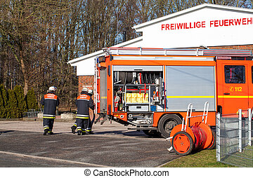 Firefighter using Emergency Vehicle