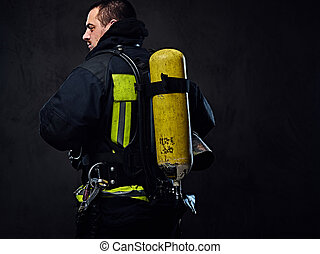 Firefighter with an oxygen balloon on his back.