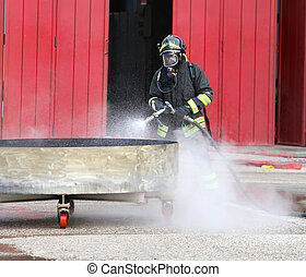 firefighter with breathing apparatus and oxygen bottles