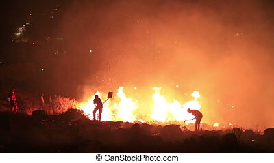 firefighters at night forest fire