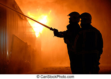 Firefighters at work - Two firefighters are trying to...